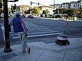 Man and delivery robot waiting at pedestrian crosing in Redwood City, California.jpg