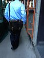 Man carrying brown satchel - IMG 6261.jpg