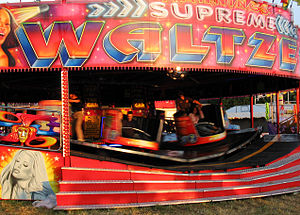 A waltzer in motion. The operator walks the bo...