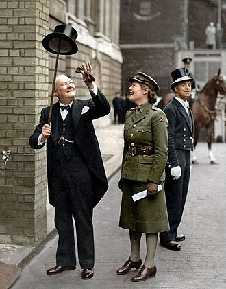 Morning dress - Winston Churchill in morning dress, lifting his top hat with his walking stick.