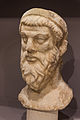 Marble unfinished sculpted head archmus Heraklion.jpg