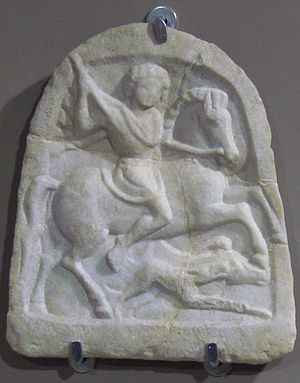 "Thracian horseman - ""Thracian horseman"" votive tablet with the standard iconographic elements: the rider is holding a lance in his right hand aiming at a boar attacked by a hunting dog."