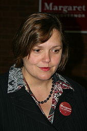 A woman wearing a suit with a Margaret Anderson Kelliher for Governor button.