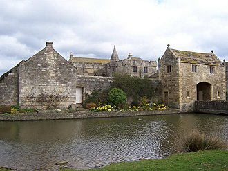 Manor house - Markenfield Hall in North Yorkshire, a 14th-century manor house with moat and gatehouse
