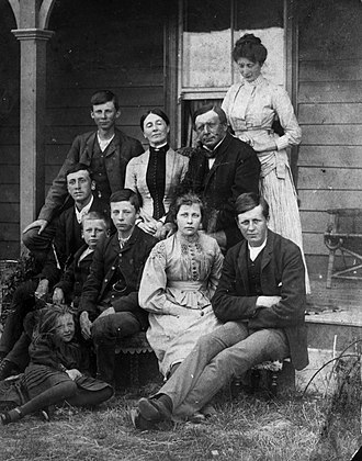 Frank Rolleston - Mary and William Rolleston and their children, at Kapunatiki; Frank Rolleston sitting in the front row in the middle