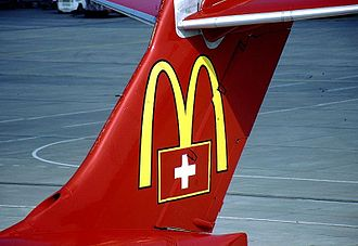 McDonald's - The McDonald's logo painted on the tail of a Crossair McDonnell Douglas MD-83 in 1999.