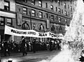 """Men carrrying banner """"Recruiting service, Man Power of Pershing"""", in downtown parade, Seattle, ca 1917-ca 1920 (SEATTLE 4294).jpg"""