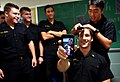 Midshipman videos himself as his head is shaved during a ceremony. (31051483576).jpg