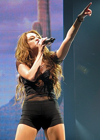 """Breakout (Miley Cyrus album) - Cyrus performing """"Wake Up America"""" on the Wonder World Tour"""