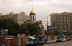 Modern Moscow; the Sanyo sign overlooks the statue of Lenin, barely visible above the billboard