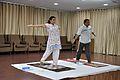 Mrs Manekar and Anil Shrikrishna Manekar - Trunk Movement - Loosening Practice - International Day of Yoga Celebration - NCSM - Kolkata 2015-06-21 7287.JPG