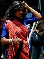 Mumbai woman in red and blue.jpg