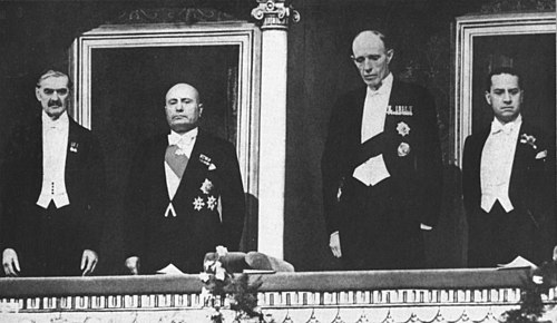 Neville Chamberlain, Benito Mussolini, Halifax, and Count Ciano at the Opera of Rome, January 1939 Mussolini and Chamberlain in Rome 1939.jpg