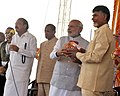 Narendra Modi handing over soil from Parliament complex & water from Yamuna river to the Chief Minister of Andhra Pradesh, Shri N. Chandrababu Naidu.jpg
