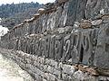 Nepal - Sagamartha Trek - 047 - Carved stones forming wall (588387537).jpg
