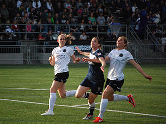 Nikki Marshall - Marshall (left) and Rachel Buehler (right) of Portland Thorns FC defend against Liz Bogus (center) of Seattle Reign FC during a match on May 25, 2013 in Tukwila, Washington.