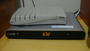 Cable television - The bottom product is a set-top box, an electronic device which cable subscribers use to connect the cable signal to their television set.