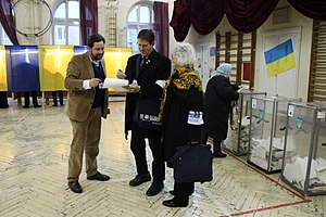 Linda Duncan - OSCE Parliamentary Assembly Mission Canadian M.P. Mark Warawa and Linda Duncan fill out Observation forms at a Polling Station in Lviv on 2014 Ukrainian Parliamentary Election Day