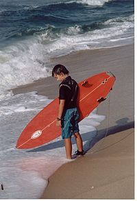 A young boy surfer