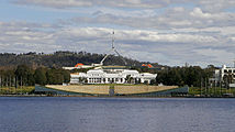 Old and new parliament houses across lake.jpg