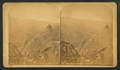 On the ragged edge. (Bottomless pot - summit of Pikes Peak, Colo.), by Martin, Alexander, d. 1929.png