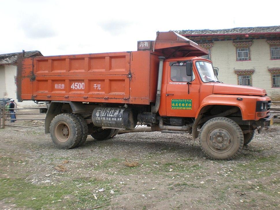 Orange Sitom truck side