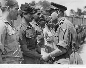 Ouvry Lindfield Roberts - Roberts greeting former Indian Army prisoners of war in Malaya, 1945.