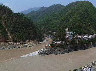 Rudraprayag - Confluence of Alaknanda (bottom, from right) and Mandakini River (flowing from top - North) at Rudraprayag.  Before 17 June 2013, there was a footbridge (jhula) over the Mandakini; this was washed away in the 2013 Uttarakhand floods.  The stones at the bottom of the stairs were not there; instead, there was a viewing platform, and a large rock called Narad Shila.