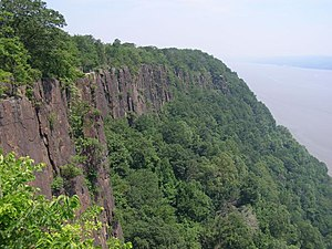 Palisades Sill - The Palisades Sill as seen from the Palisades Interstate Parkway. The Hudson River is the background.