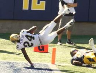 Paul Perkins - Perkins scoring a touchdown in college with UCLA.