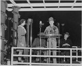 Photograph of a Boy Scout speaking at the ceremonial lighting of the National Community Christmas Tree on the White... - NARA - 199269.tif