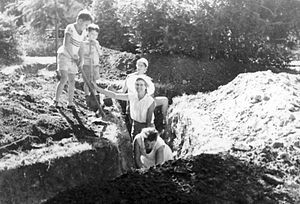 Controversies relating to the Six-Day War - Israeli women and children dig trenches at Gan Shmuel. The photo was taken during the waiting period in the days preceding the Six-Day War.