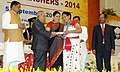 Pranab Mukherjee presenting the National Award for Teachers-2014 to Smt. Aisema Tang, Arunachal Pradesh, on the occasion of the 'Teachers Day', in New Delhi. The Union Minister for Human Resource Development.jpg