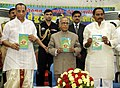 Pranab Mukherjee unveiling a special souvenir during conferring the award to meritorious students of SV Vedapatasala Dharmagiri, at Tirupati. The Governor, Andhra Pradesh, Shri E.S.L. Narasimhan and the Chief Minister.jpg