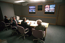 President George W. Bush conduct a video tele-conference at Offutt Air Force Base.jpg