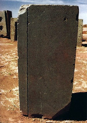 Pumapunku - Detail of stone with precisely cut straight line and tooled holes within the line