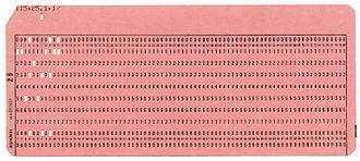 Plugboard - An 80-column punched card. Rows 0 to 9 are labeled. The 12 row, on top, has one punch in column 7. The 11 row, below it is not punched on this card. As cards passed through a read station, usually 9-edge (bottom edge) first, wire brushes, one for each column, would make contact through the holes.