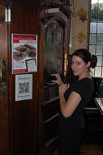 QRpedia code being scanned at The Bartons Arms.JPG