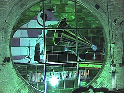 "Although it is not original, the Nipper stained glass remains illuminated atop the ""Nipper Tower"" in the former Building 17. This photograph was taken from the inside of the ""Nipper Tower""."