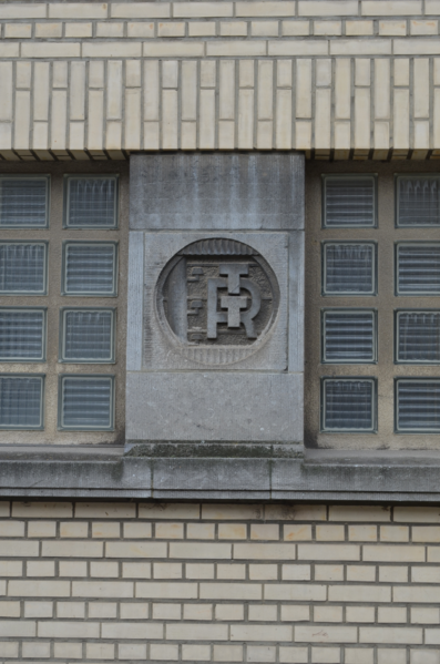 Logo of the Belgian Telecommunications Company RTT engraved in stone in an old building of the RTT, now Proximus