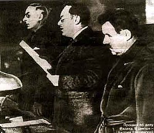 Moscow Trials - Prosecutor General Vyshinskiy (centre), reading the indictment, in 1937