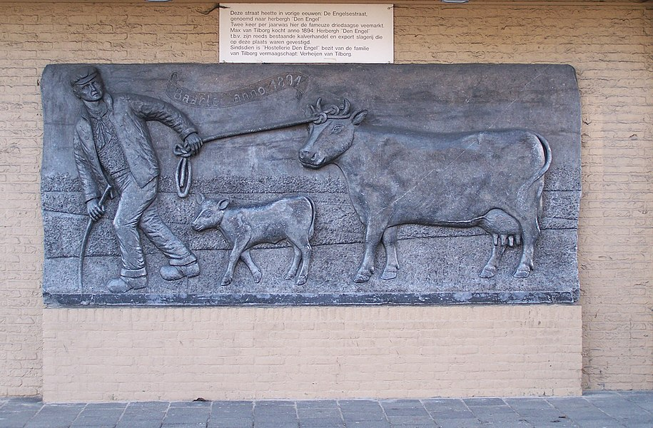 """Relief made by Constant Grooten in 1994 celebrating the 100st anniversary of Hostel """"Den Engel"""". Placed at the Sint Annaplein in Baarle Nassau."""