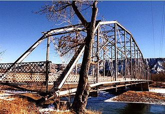Rifle, Colorado - Rifle Bridge in winter on the Colorado River. The bridge, built in 1909, is now closed to traffic and is listed on the National Register of Historic Places.