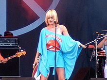 Robyn onstage in an off-the-shoulder blue outfit