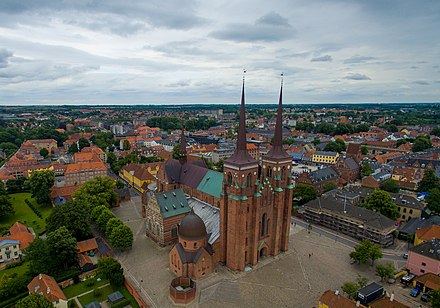 Roskilde Cathedral has been the burial place of Danish royalty since the 15th century. In 1995 it became a World Heritage Site. Roskilde Cathedral aerial.jpg