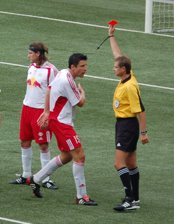 A player is shown a red card to indicate his dismissal from the game. Rote Karte-RB Salzburg crop.png