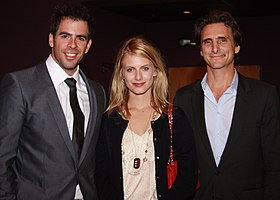 Laurent standing alongside Eli Roth and Lawrence Bender posing for the camera.