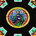 Saint Mary of the Immaculate Conception Church (Rushville, Indiana) - stained glass, transept, St. Joseph rose window - detail.jpg