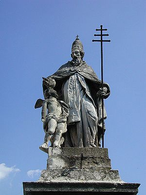 Papal cross - Statue of Pope Sylvester I depicted holding a ferula with a papal cross.