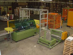 Shrink wrap - A machine designed to continuously wrap up to 35 packets per minute